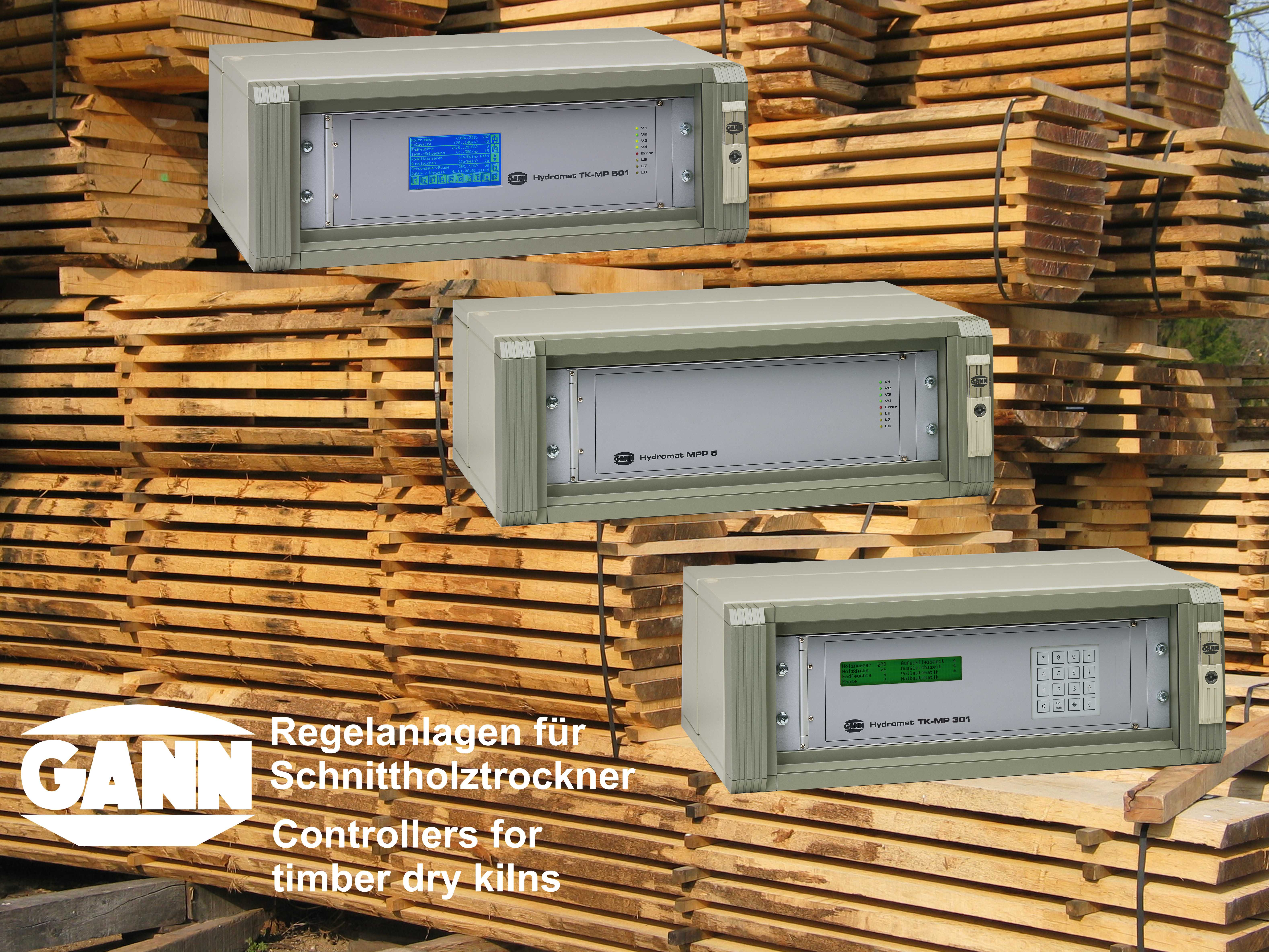 Moisture meters and company logo in front of background image showing stacks of sawn timber